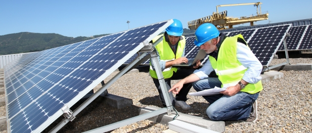 bigstock-engineers-checking-solar-panel-20502491.jpg